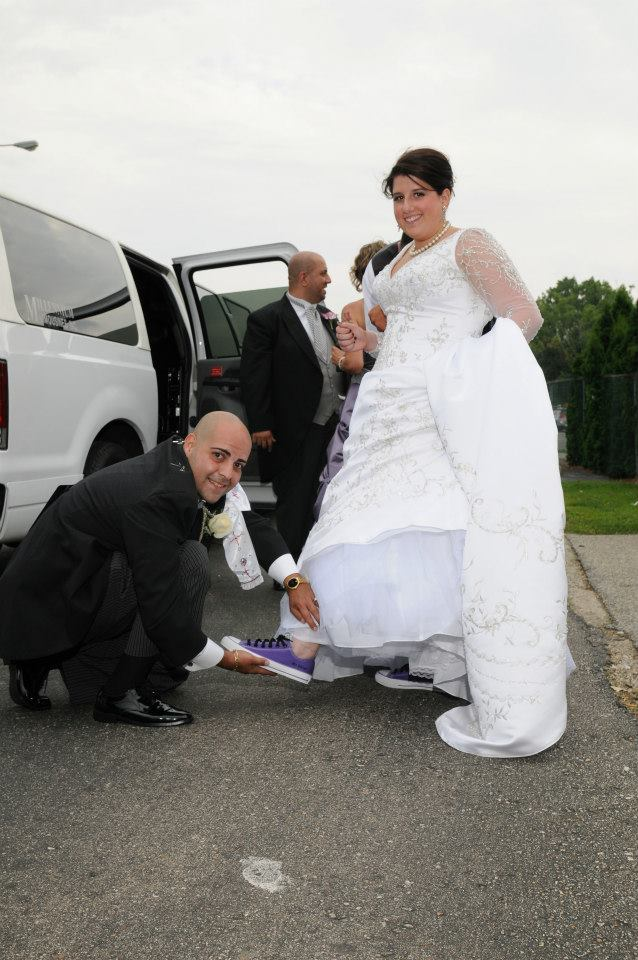 Bride with groom tieing the shoes.jpg