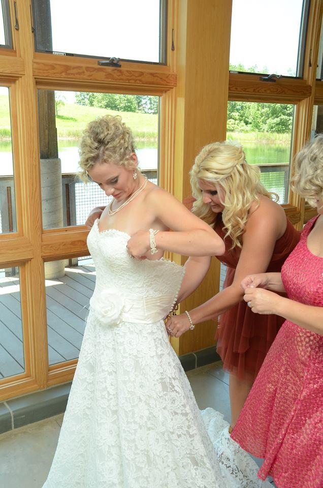 bride getting dresses in gown.jpg