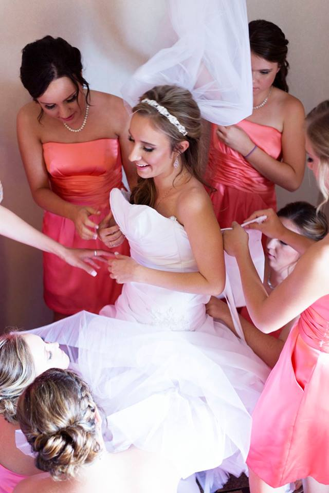 Samantha getting gown corsetted.jpg