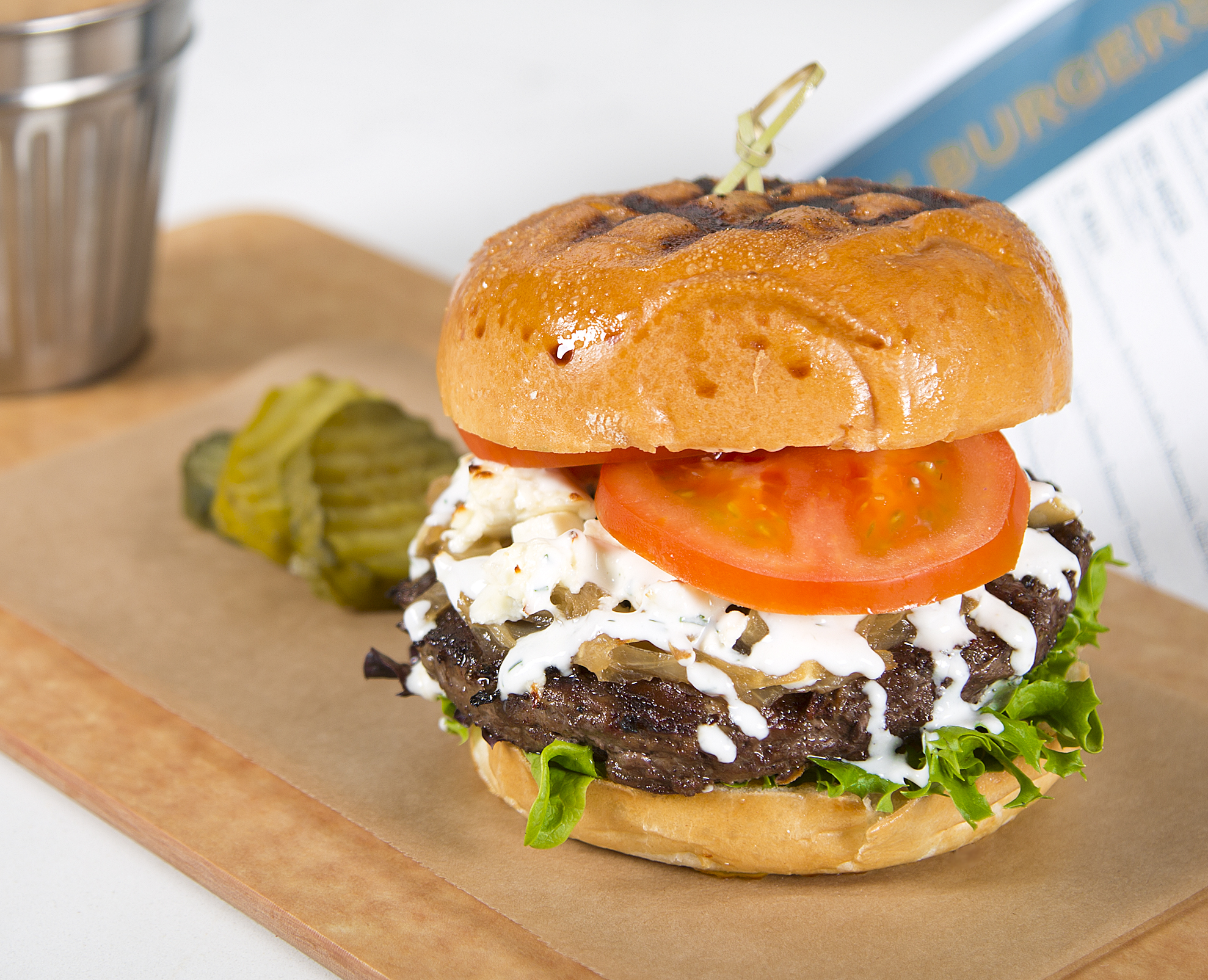 LITTLE BO PEEP   Spiced Artisan Lamb Burger, Caramelized Onions, Aged Feta Cheese, Field Greens, Florida Tomato, Tzatziki Sauce, Pita Round