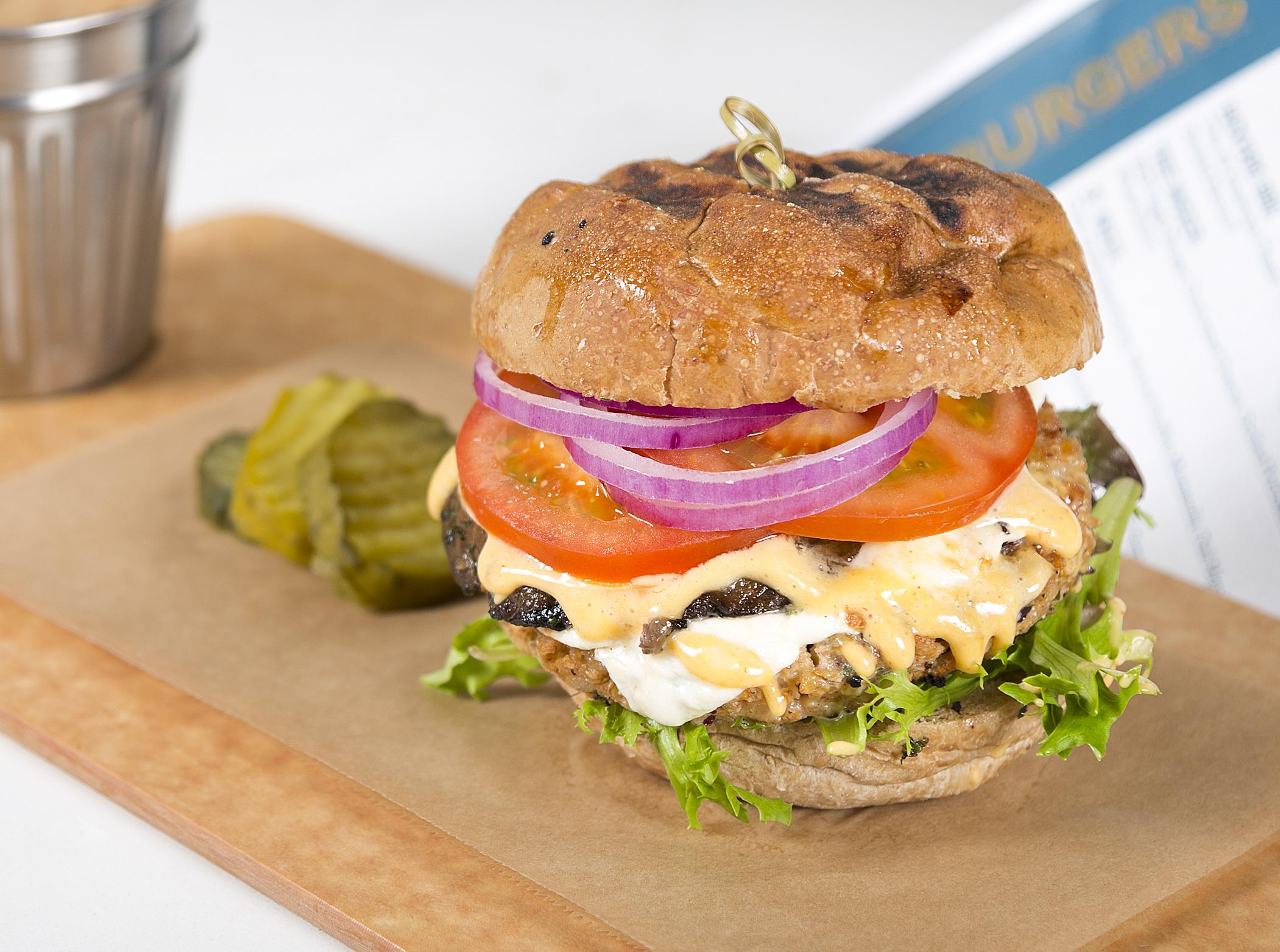 TREE HUGGER   Housemade Vegetarian Burger, Garden Greens, Grilled Portobellos, Melted Mozzarella, Florida Tomato, Avocado, Onions, Spicy Aioli, Toasted Wheat Roll