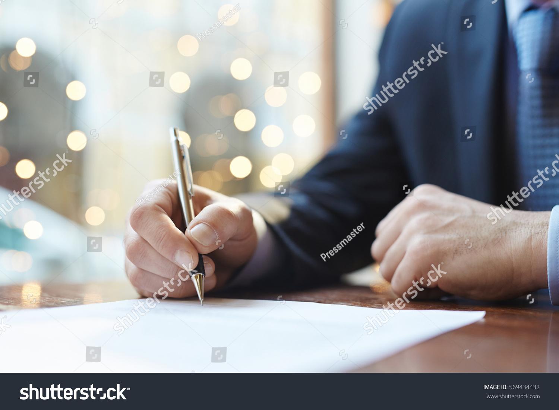 stock-photo-signing-agreement-569434432.jpg