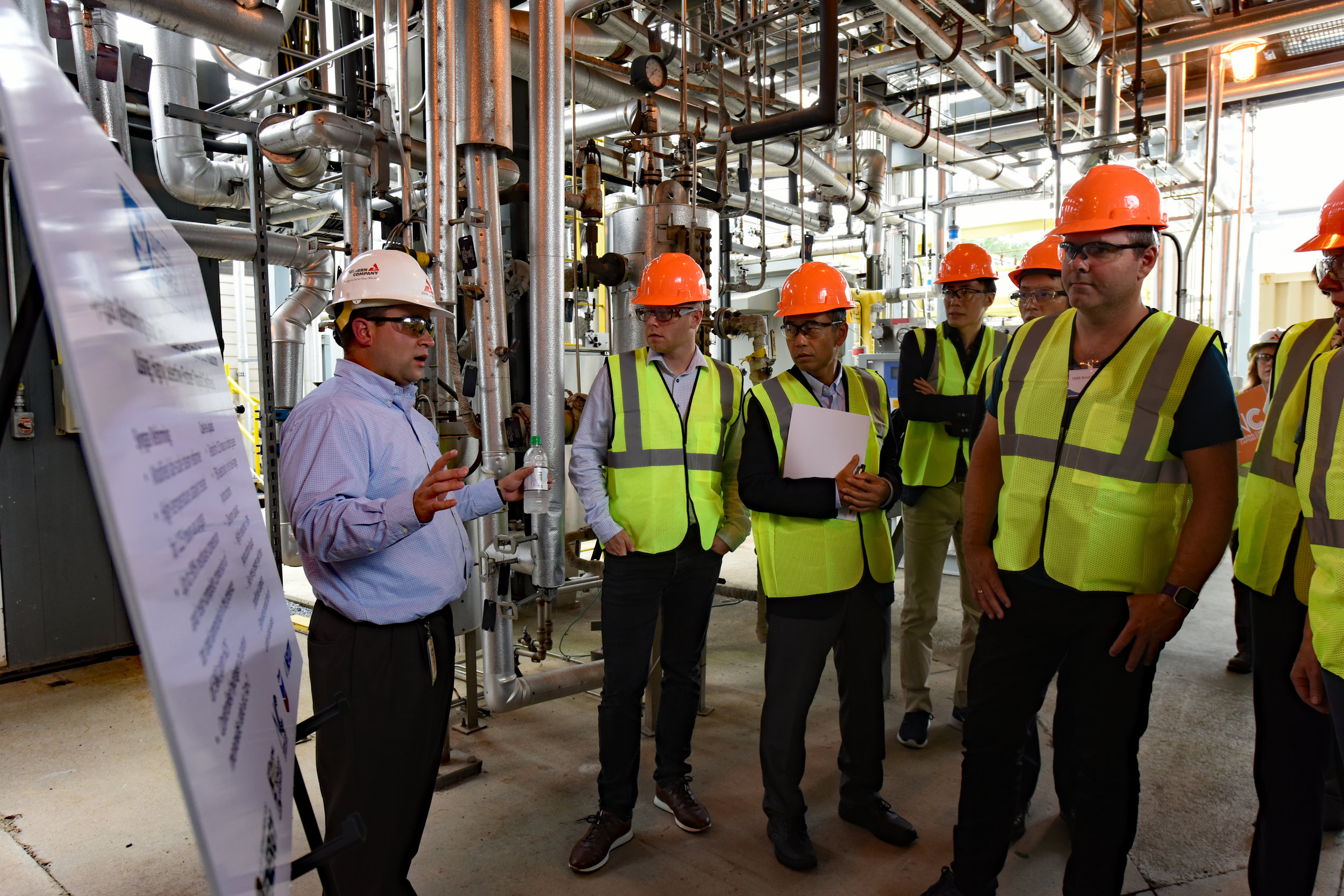 Senior engineer John Carroll, left, describes a project underway with technology partner Southern Research, of Birmingham.