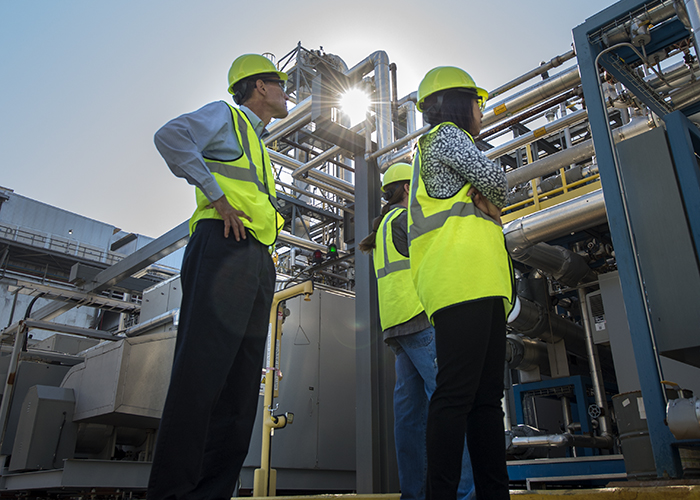 Participants take in the scale of post-combustion technology installed at the National Carbon Capture Center.