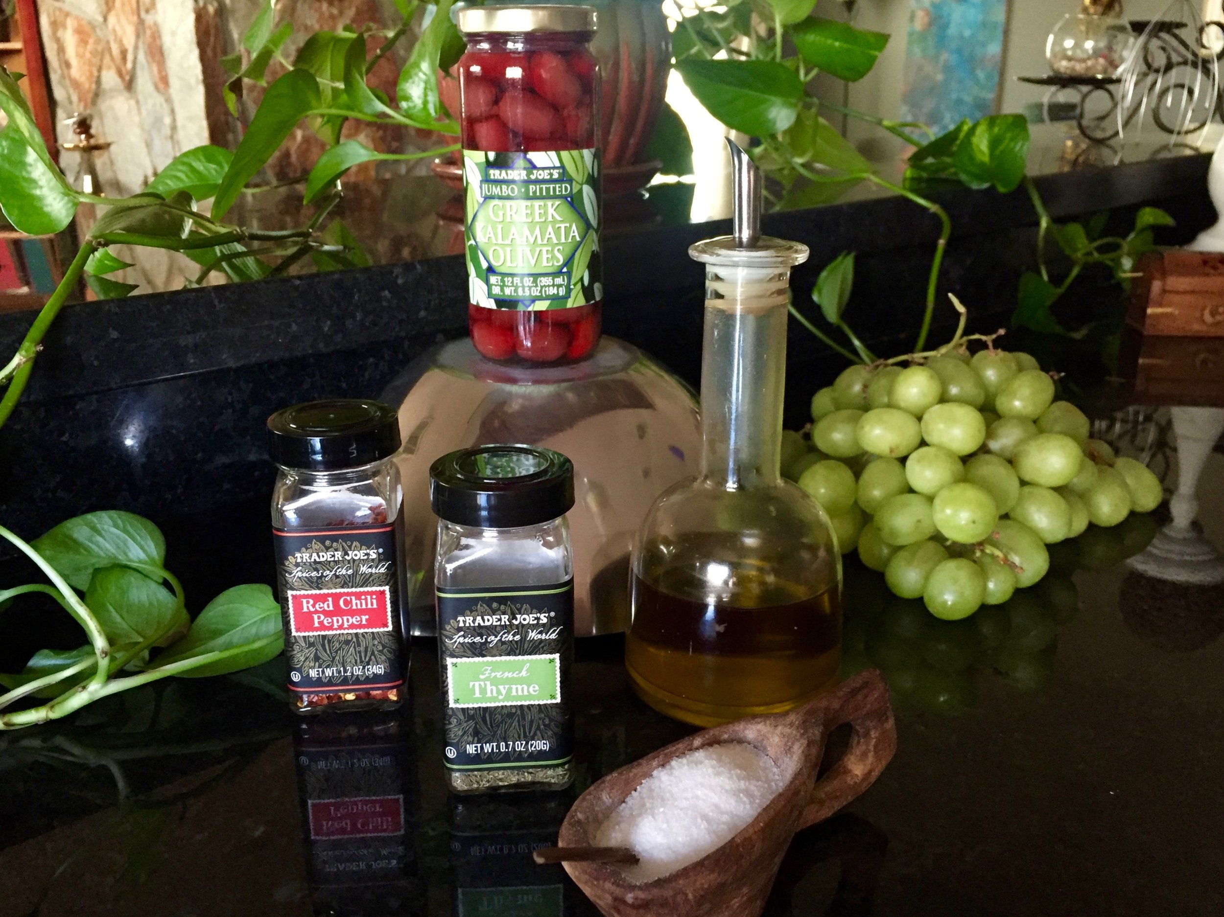 Setup : kalamata olives, green grapes, olive oil, salt, thyme, red chili pepper flakes