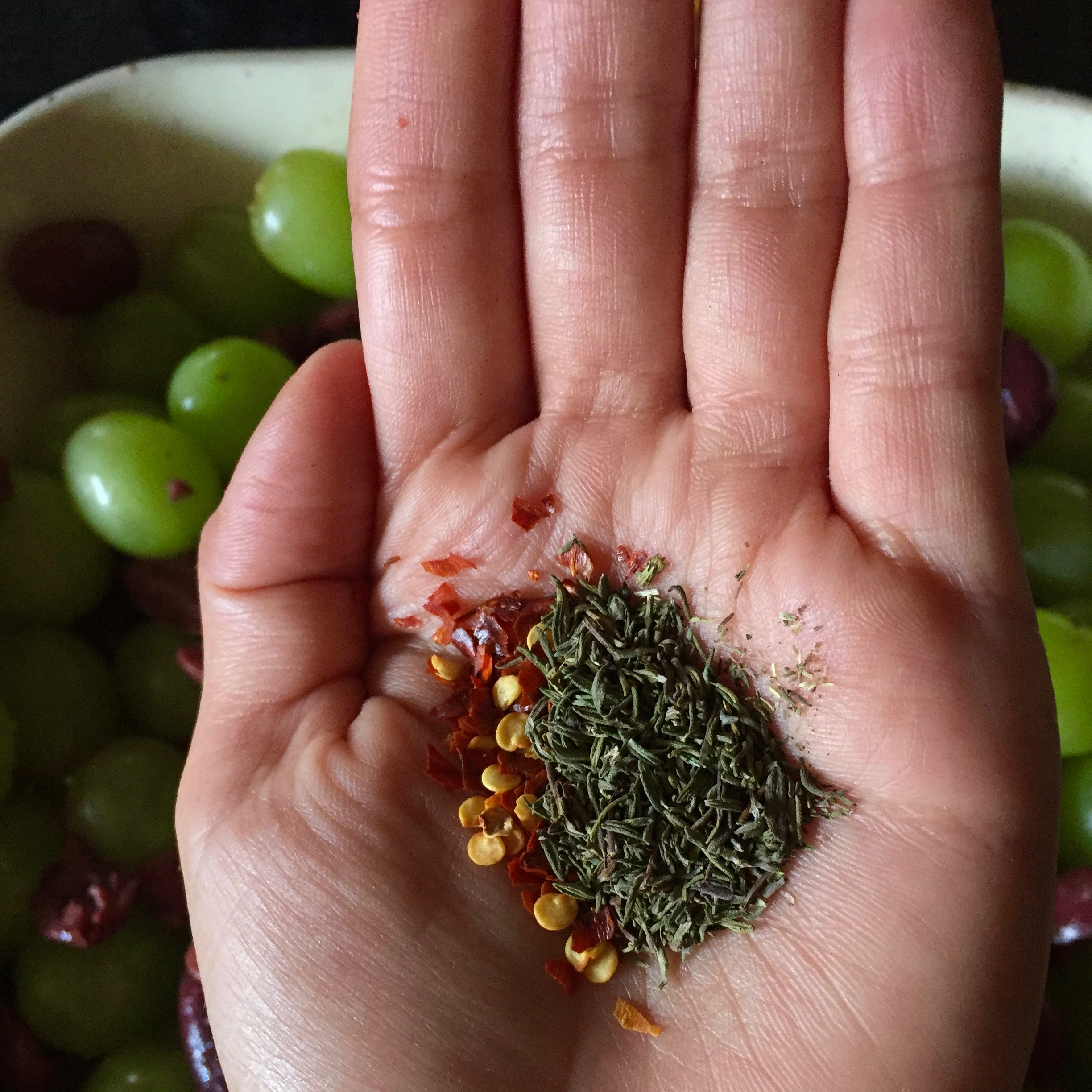 Crumble the thyme, a rough chop, if you're using fresh, salt, and red pepper flake. Sprinkle over mixture.