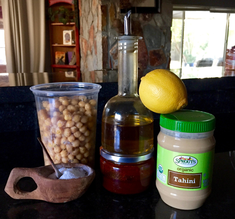Cooked chickpeas, olive oil, lemon, tahini paste, harissa paste, salt