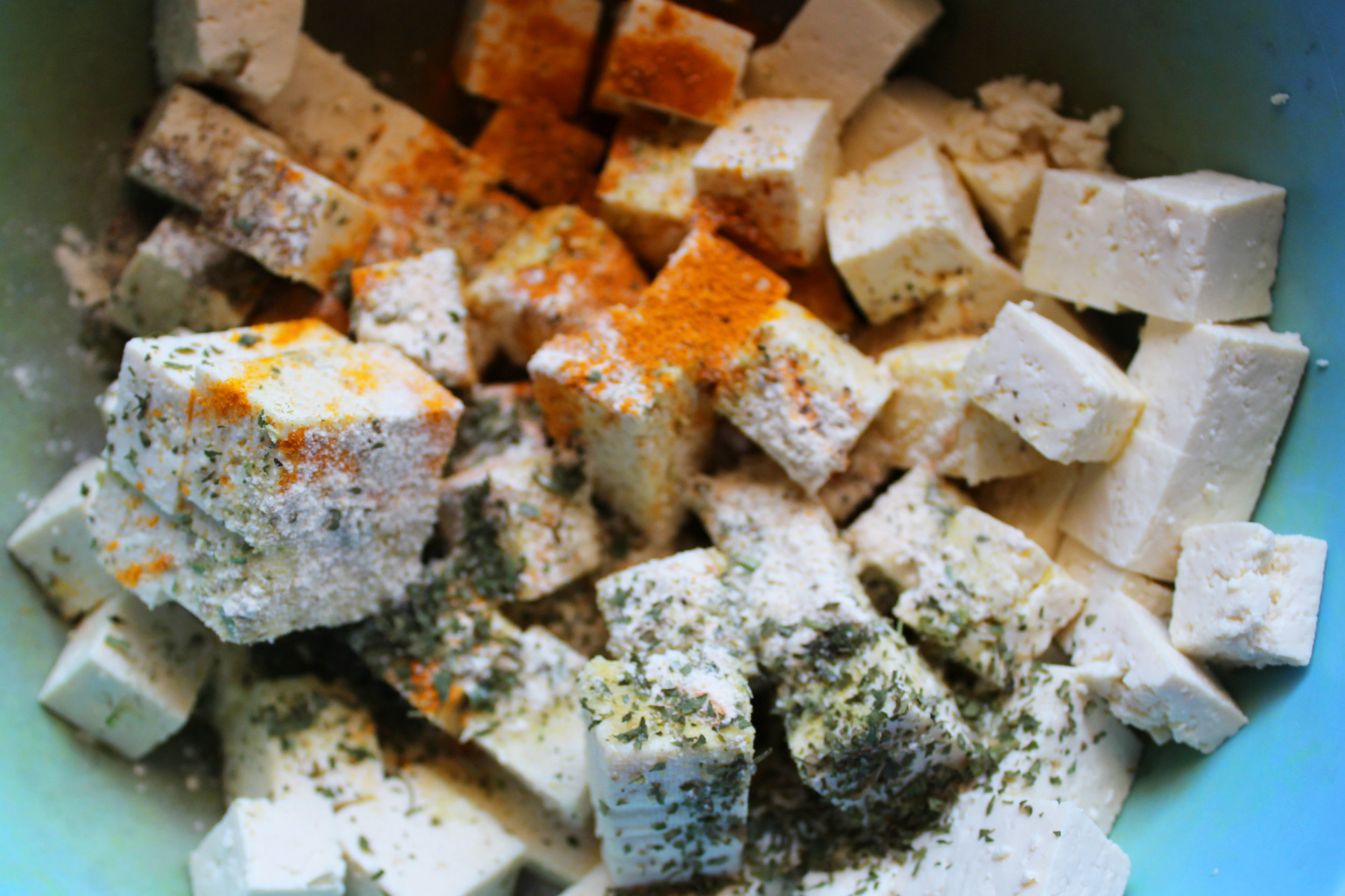 Season the tofu. toss to combine, careful not to break the tofu squares!