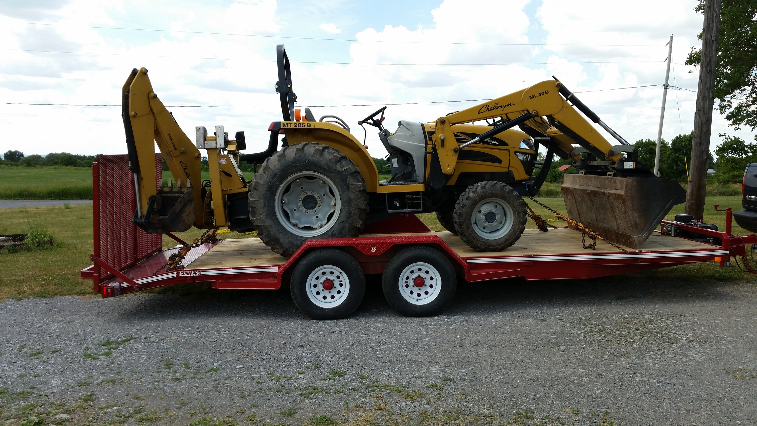 Backhoe on CornPro trailer.jpg