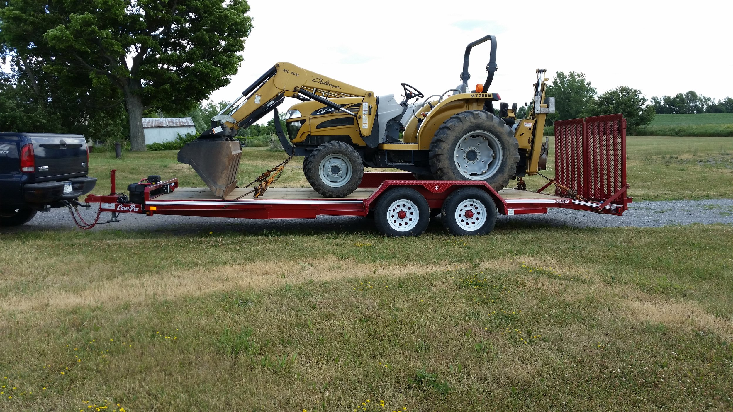 Backhoe on CornPro Trailer 2.jpg