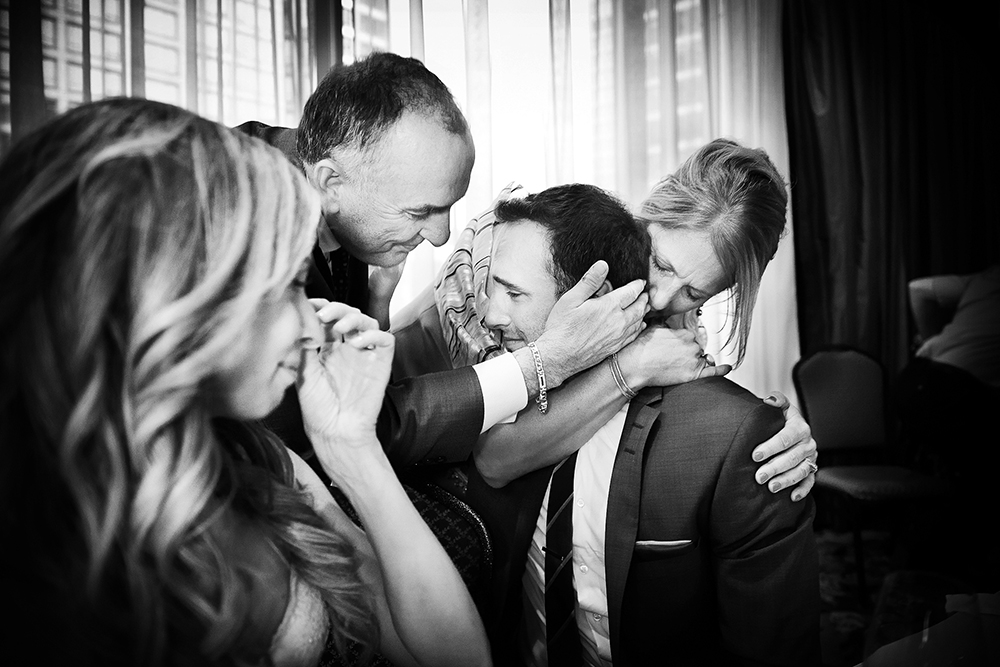wedding family embracing at union club, vancouver