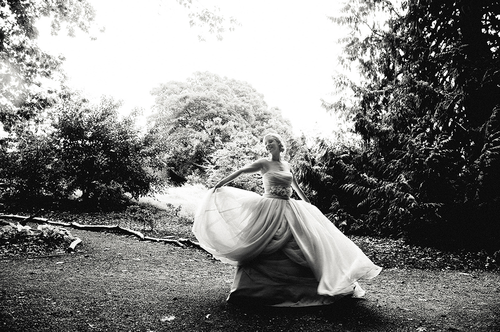 bride twirling and dancing on the grounds of hatley castle
