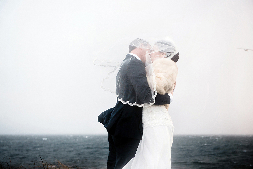 wedding couple kissing during a windy storm, victoria bc