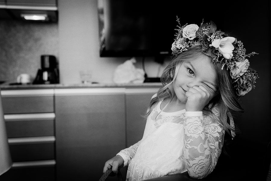 flower girl with head dress looks at camera, Victoria BC