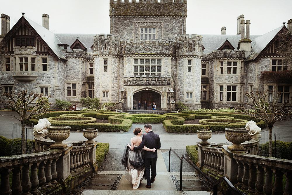 wedding couple embraces walking towards Hatley Castle