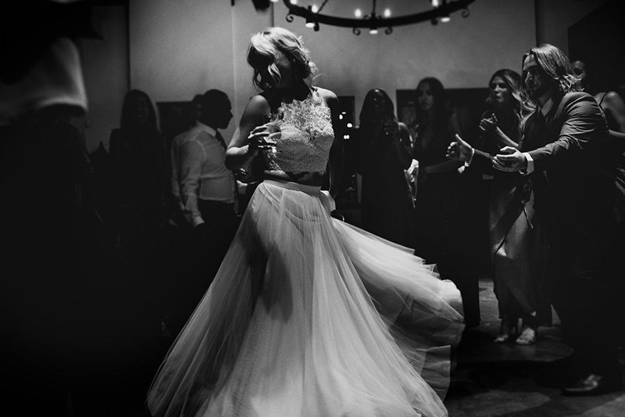 bride twirls in her wedding gown at Sea Cider House