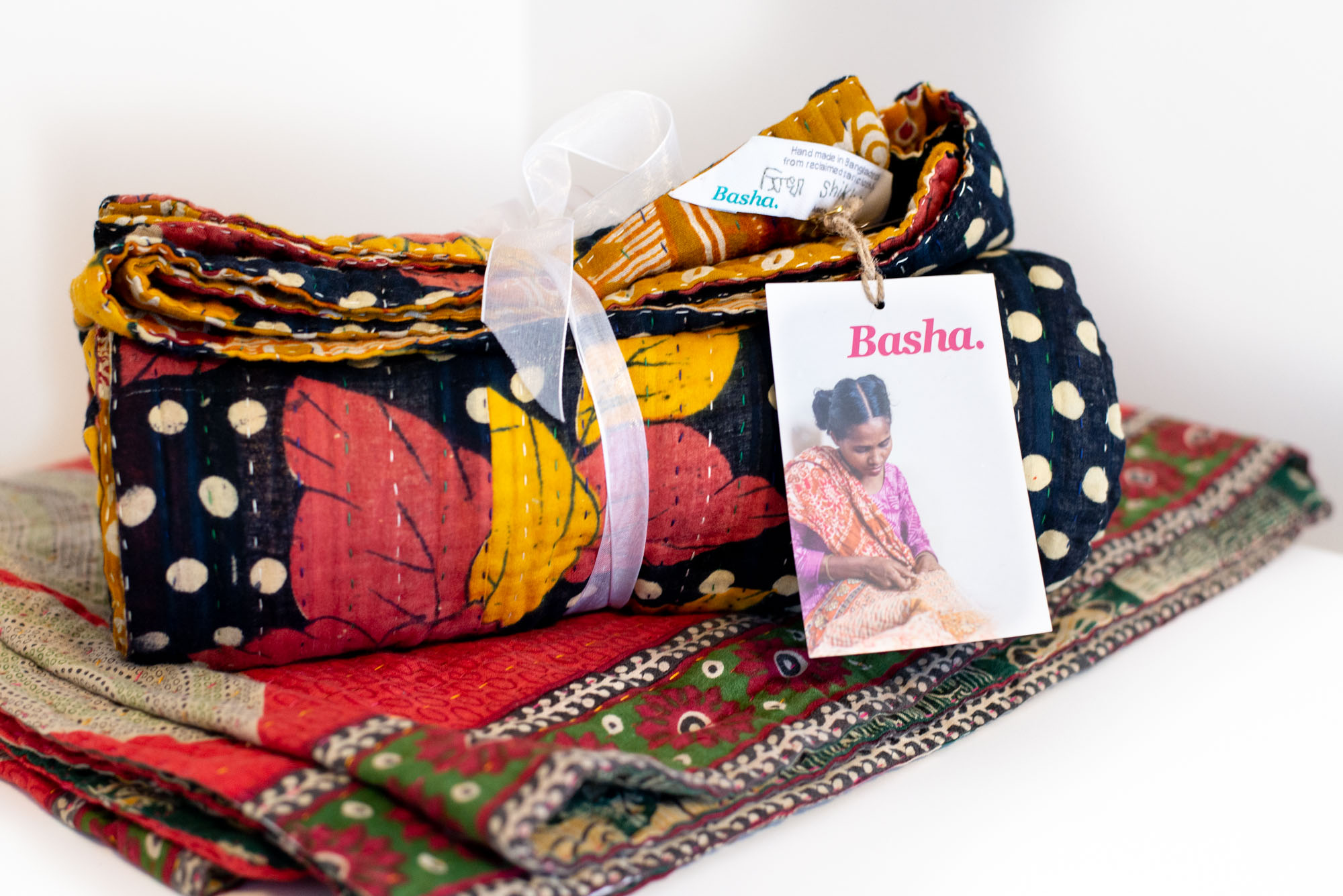 Basha: Hand Stitched Sari Blankets - Basha creates high quality, unique, handmade products which reflect their love for the traditions of Bangladesh while employing women at risk and survivors of trafficking.
