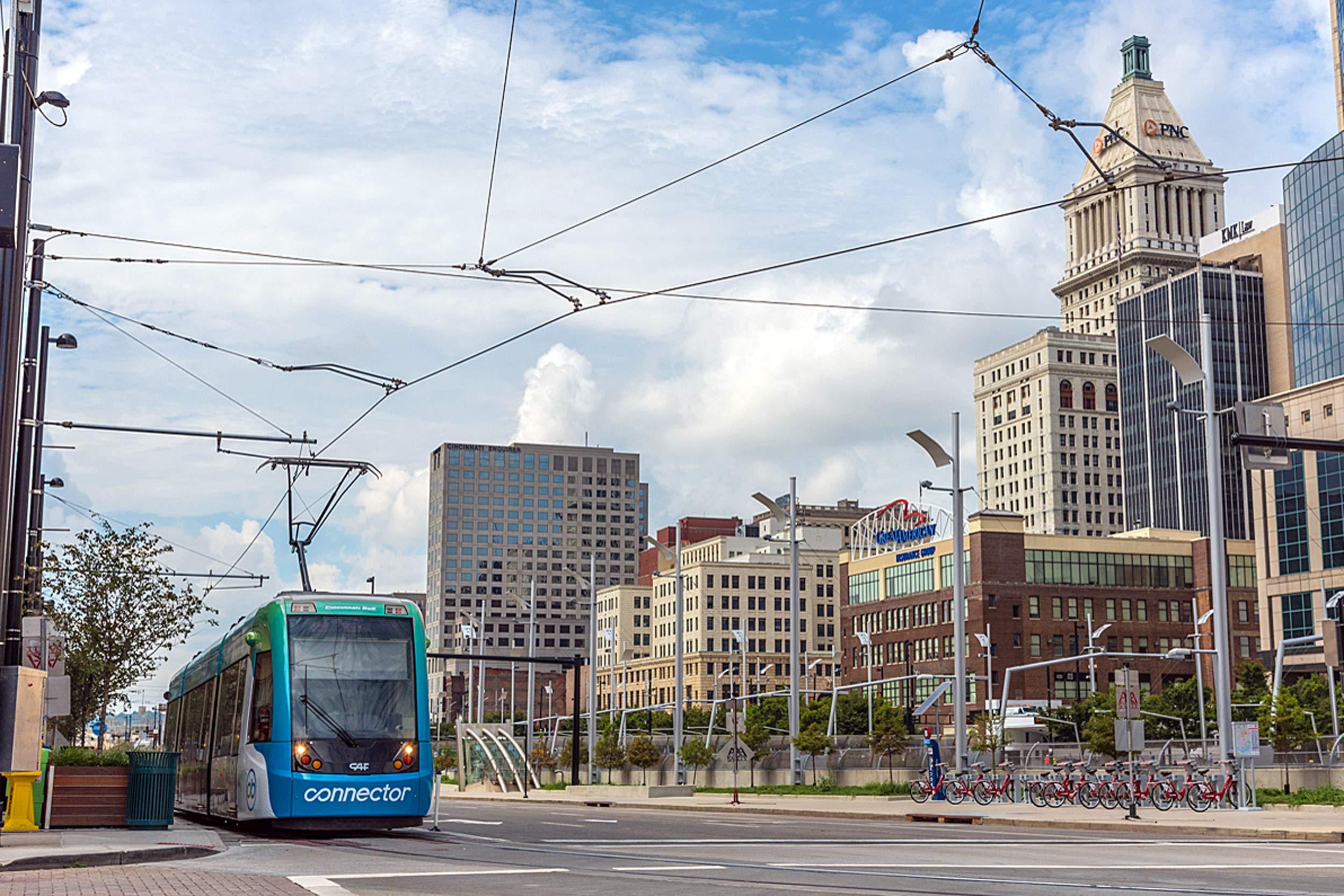 Cincy-Streetcar-w-City-w-OCS-and-City-in-Background.jpg