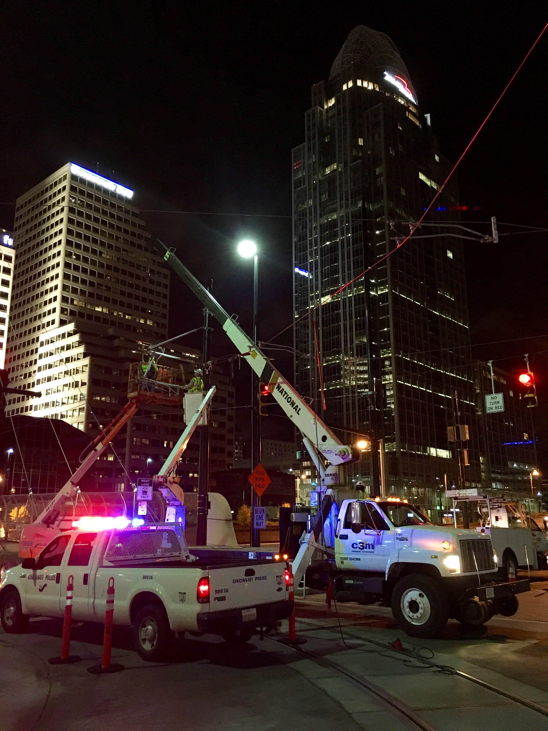 Cinci Streetcar Guys Working at Night.jpg