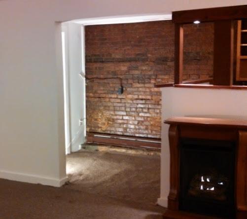 137 bsmt fireplace entry.jpg
