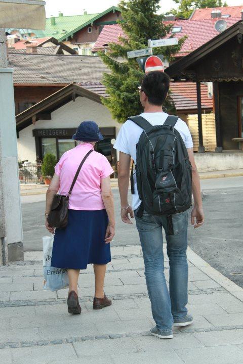 Back shot of Marianne Behn & my husband Jason walking