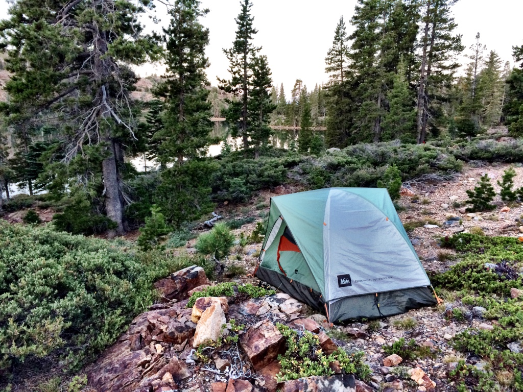 Setting up tent in the middle of the wilderness in Tahoe National Forest, by Rock Lake