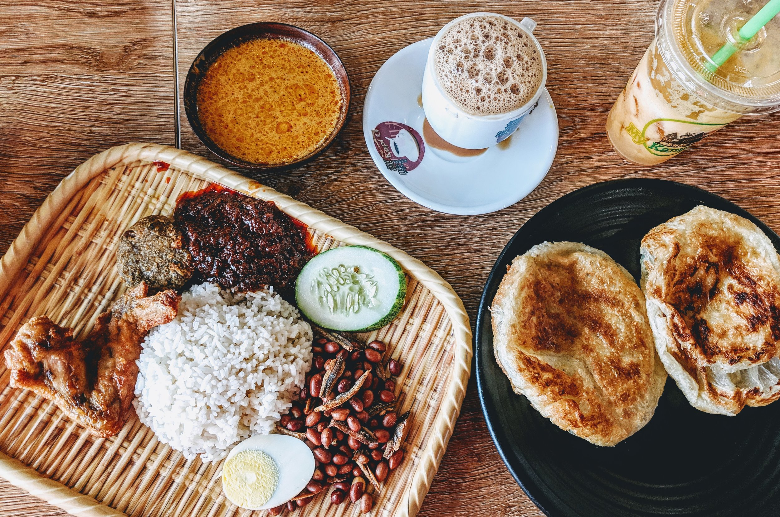 This is a typical and oh so delightful meal in Singapore and Malaysia. Left: Nasi lemak (coconut rice with chicken or fish, egg, peanuts, anchovies and spicy sambal chilli). Right: Roti prata (flattened and crispy bread). Top: Milk teas. From this picture, can you guess what I eat and what I don't eat?