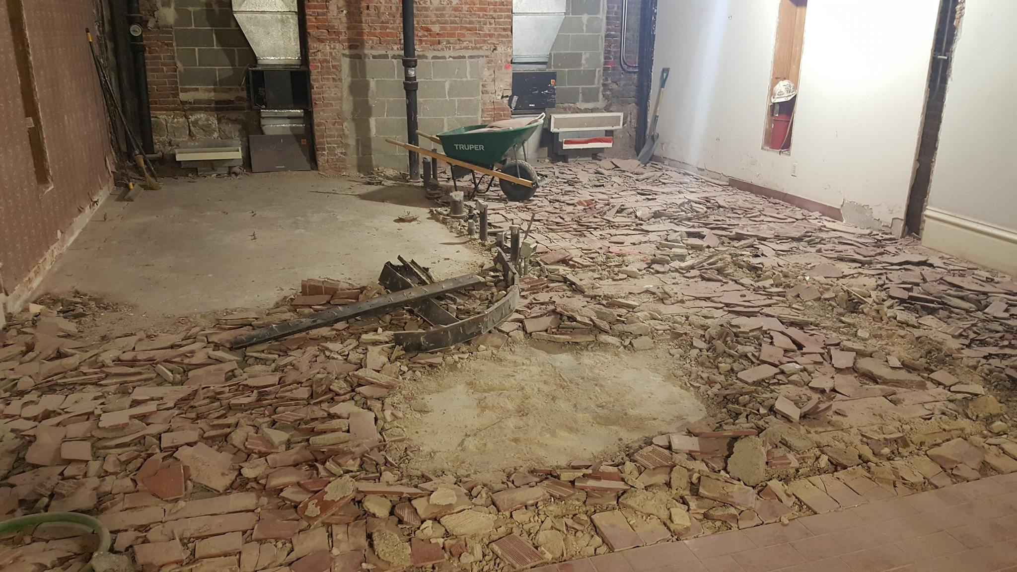 removal of the %22brick%22 quarry tile in the public restroom area-min.jpg