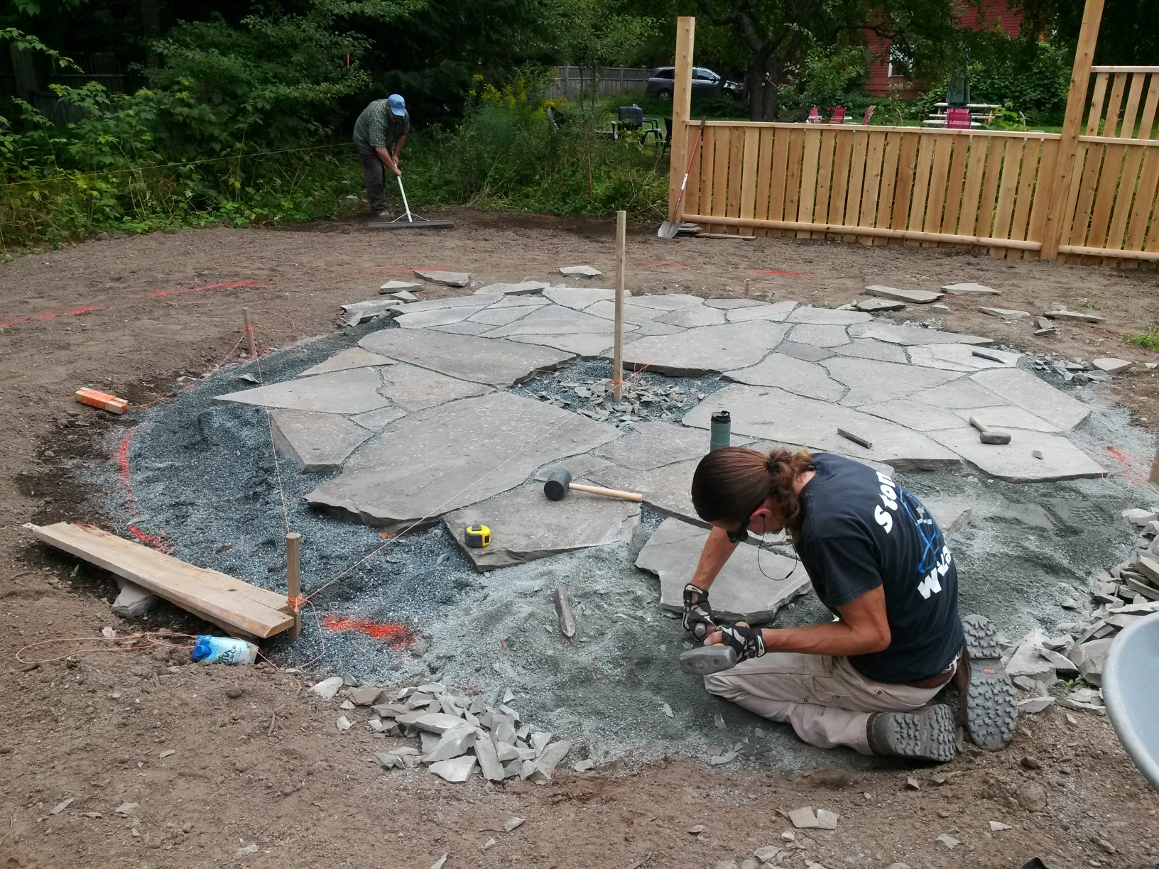 Stone Wiz working on a firepit patio