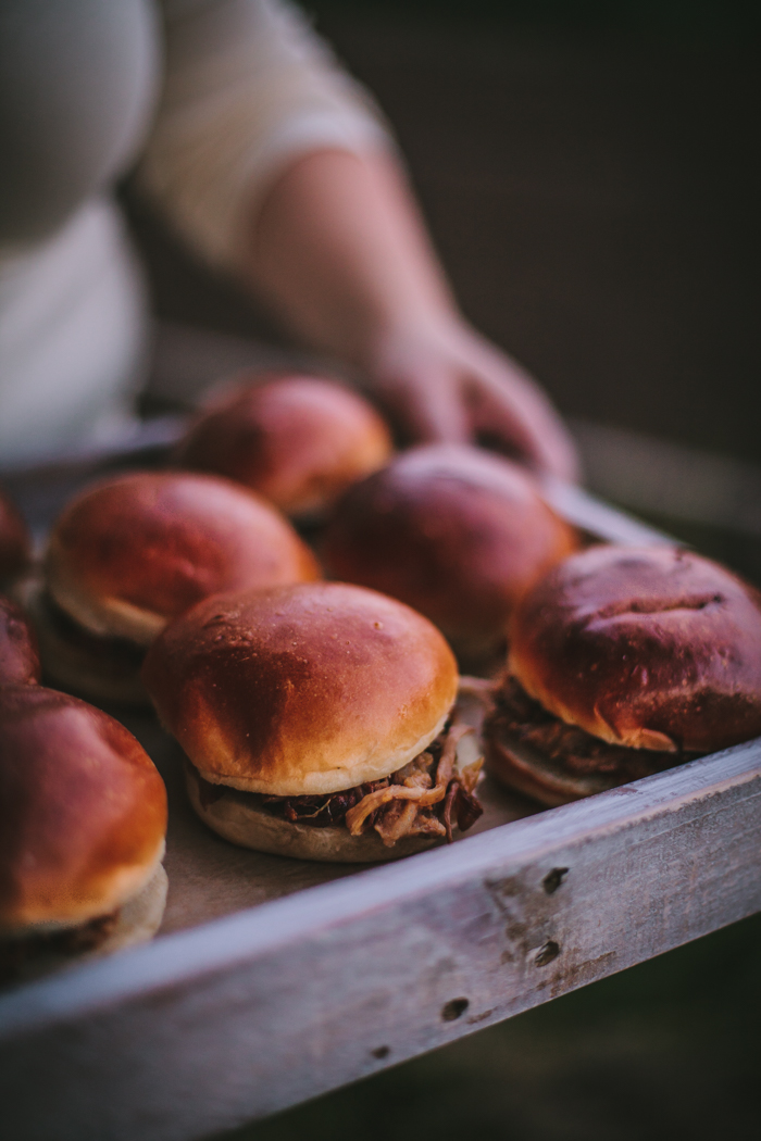 Keep the main simple - These pulled pork sandwiches are a perfect main dish for a casual summer dinner, especially when serving a crowd! They're incredibly flavorful and fool proof.! The pork shoulder is slow cooked with apple cider and vinegar to create the most juicy meat while dried figs and spices make for a heavenly mix to make this a slightly spicy and sweet sandwich. We promise this is a crowd-pleaser, get the recipe below!