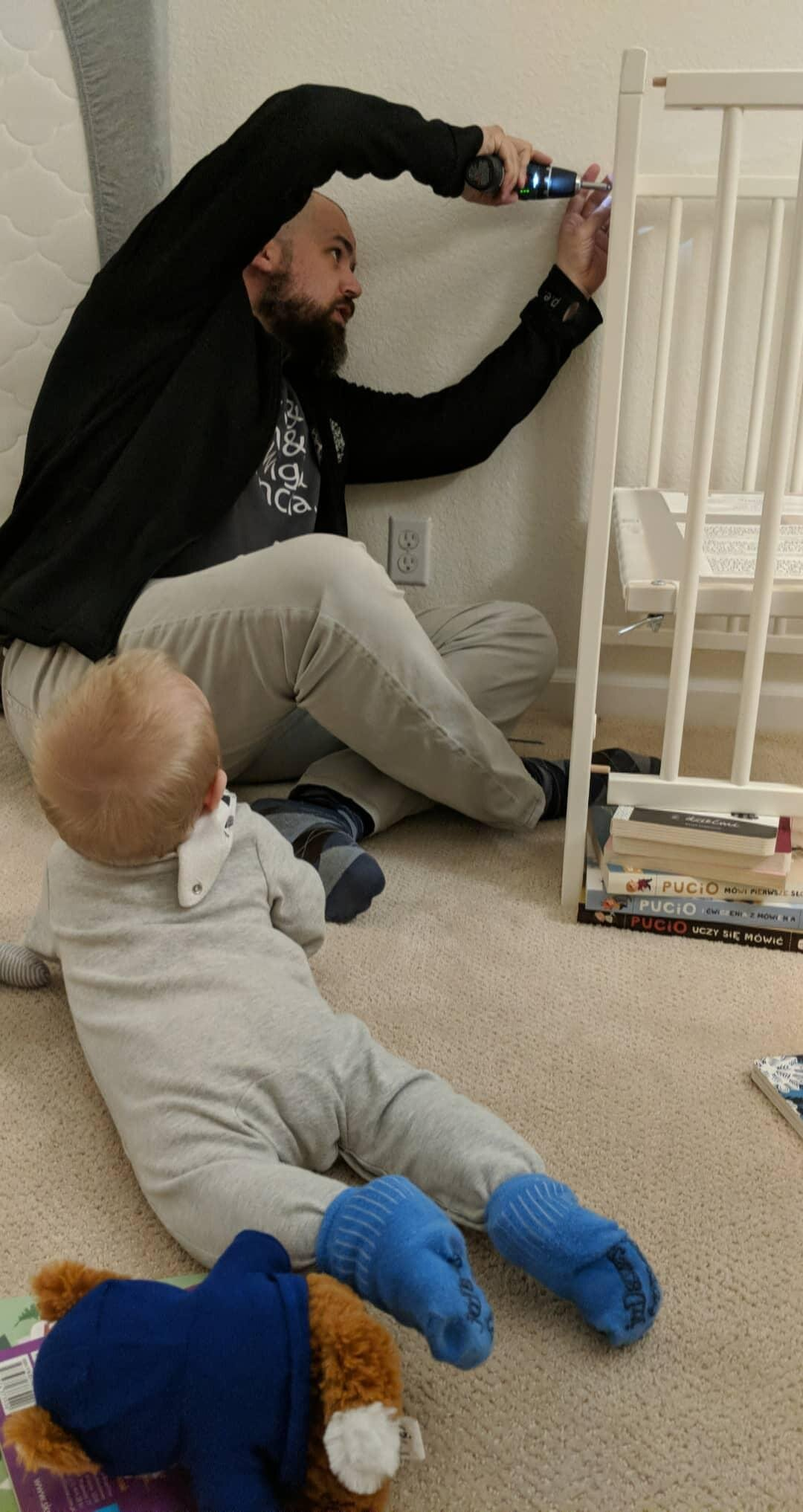 Installing the Ikea crib.