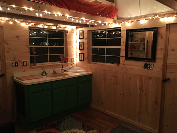 Tiny house is 120 sq ft. Includes two sleeping lofts with blankets/linens, fridge and mini kitchen, running water, electricity, books and a deck that overlooks the creek. Bathroom is a separate structure a short distance from the tiny house and includes a propane heated outdoor shower and a composting toilet shared with our intern.
