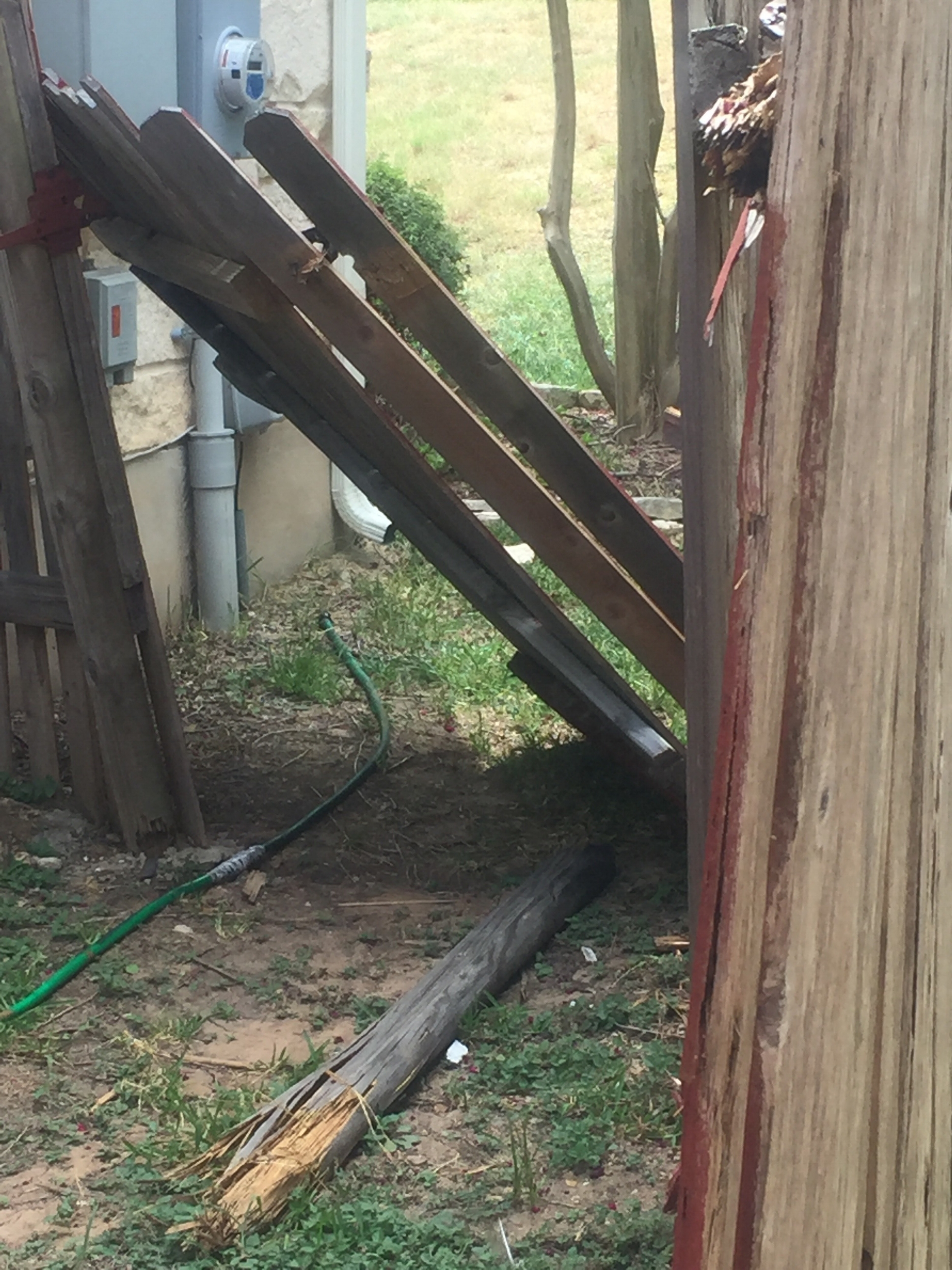 Unacceptable - Gate post broken.  Not structurally sound.