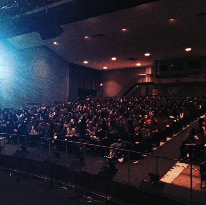 An audience of students at Rosedale Heights School of the Arts during a post-performance Q&A session.