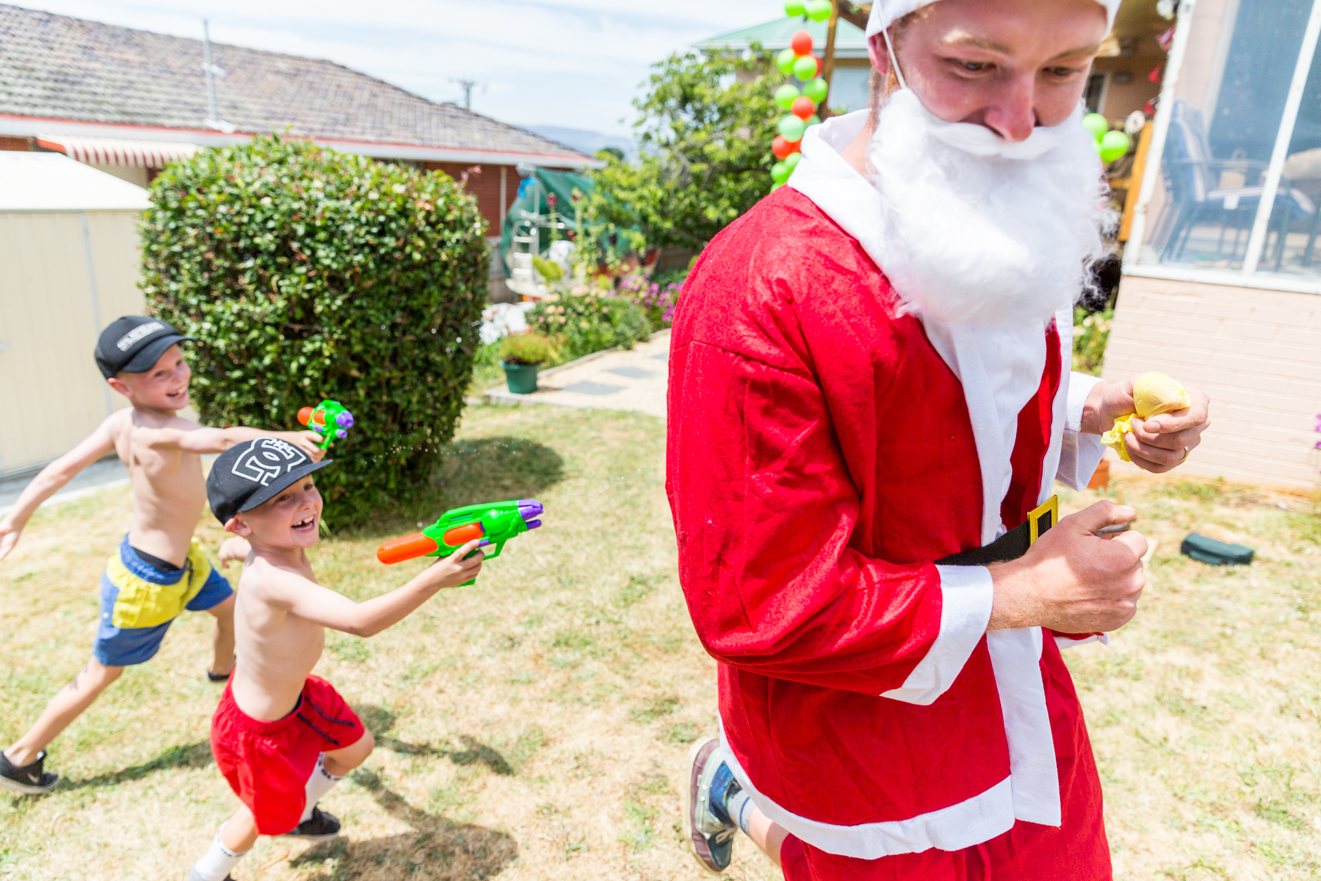 After lunch my brother put on a red suit to distribute gifts we bought for the kids 'from Santa'. The kids could see Don's ginger whiskers under the fake beard, and thought it would be more fun to shoot him with water pistols rather than open presents. Hilarity ensued.