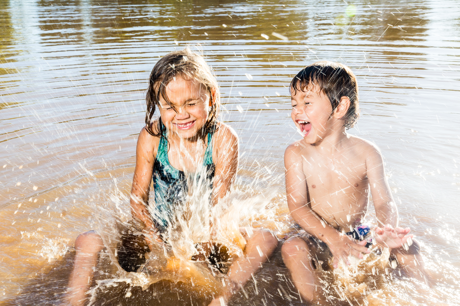 I found Pearl and Lachlan splashing in the river at the north of town and took this photo for the paper. I got very wet.