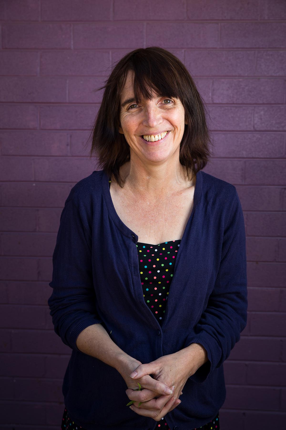 Sarah Brown in front of the purple walls of Western Desert Dialysis in Alice Springs