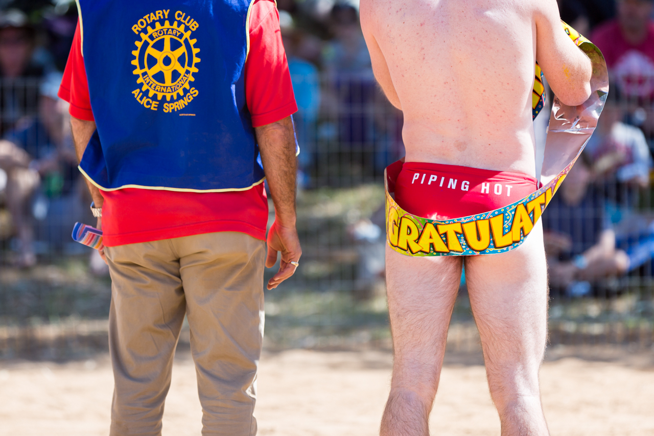 A competitor waits for the highly anticipated budgie smuggler race in the dry sand of the Todd River