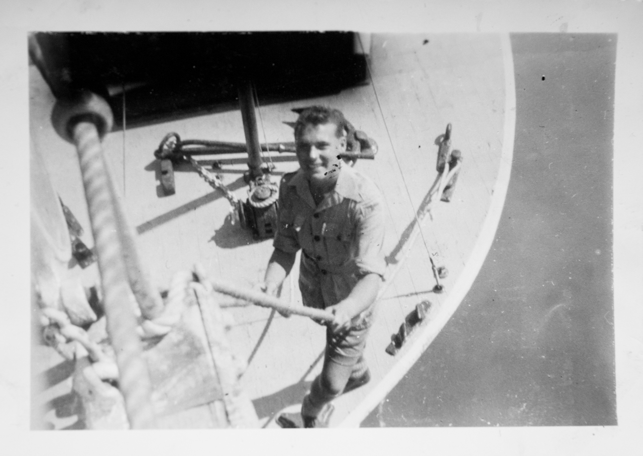 Ted's brother, Ray, in a boat tied to the Mooltan in the Suez Canal