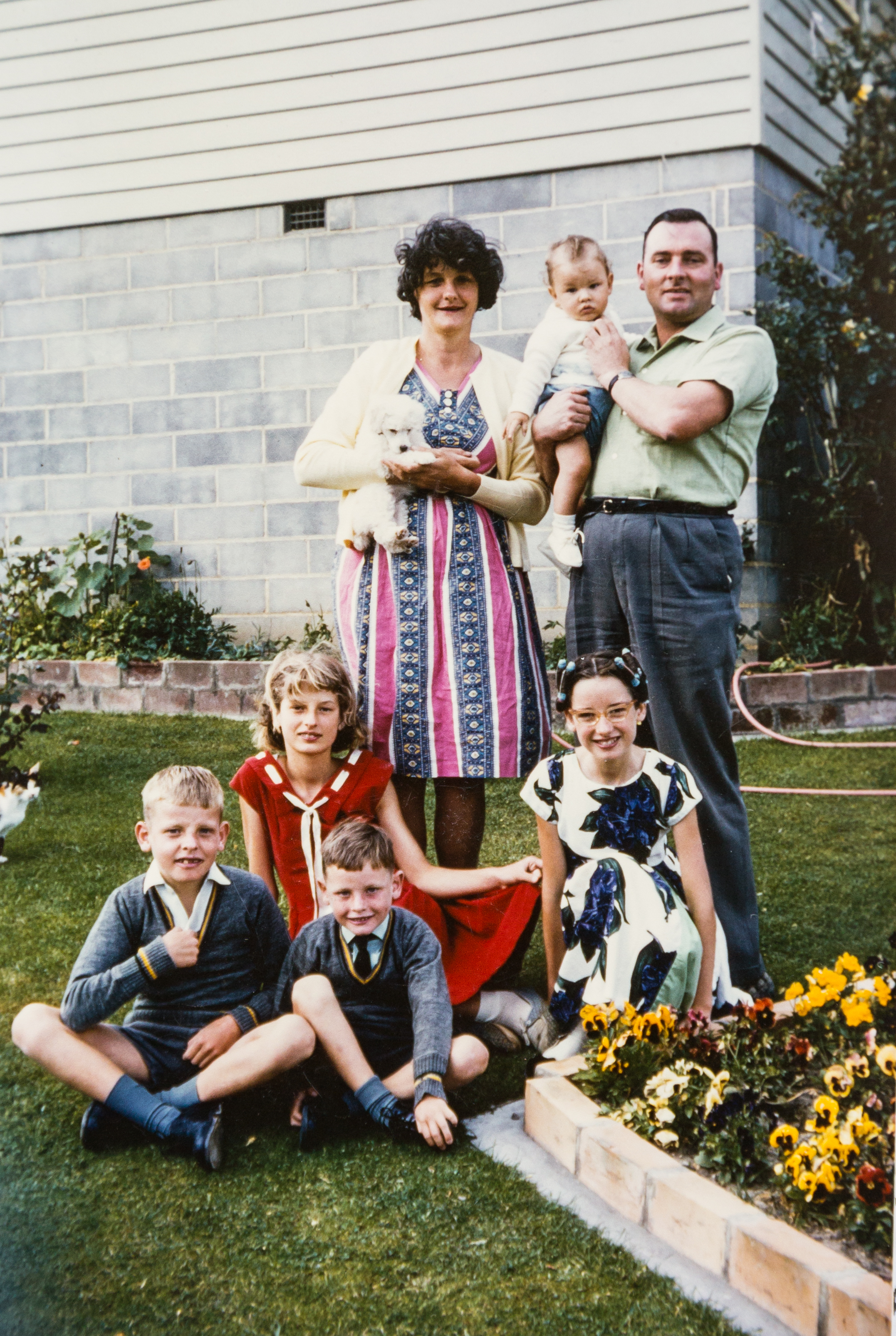 Ted and Tessie on their front lawn with their children Ann, Teddy, Phillip, Pam, and Peter