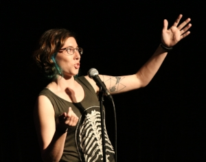Rose, reaching for the stars on the Story Collider stage in Brooklyn.