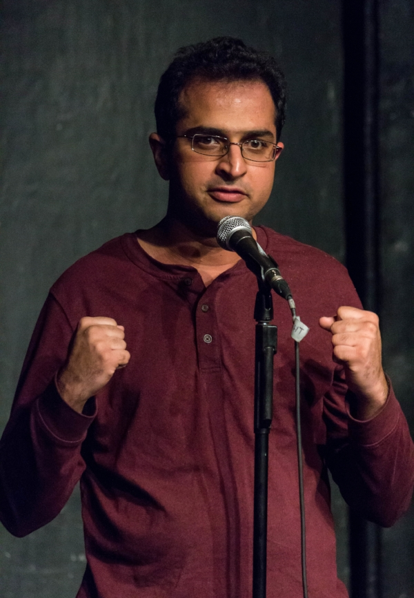 Saad Sarwana tells his story at the Kraine Theater in New York. Photo by Nicholas Santasier.