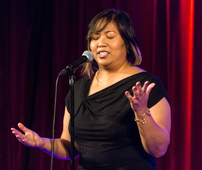 Jean Zarate shares her story at the Bell House in New York. Photo by Nicholas Santasier.