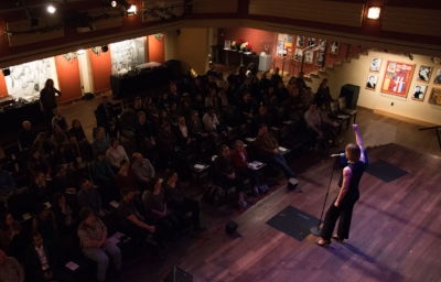 Sarah Myhre holds up a fist at the end of her story. Photo by Finn Turnbull.