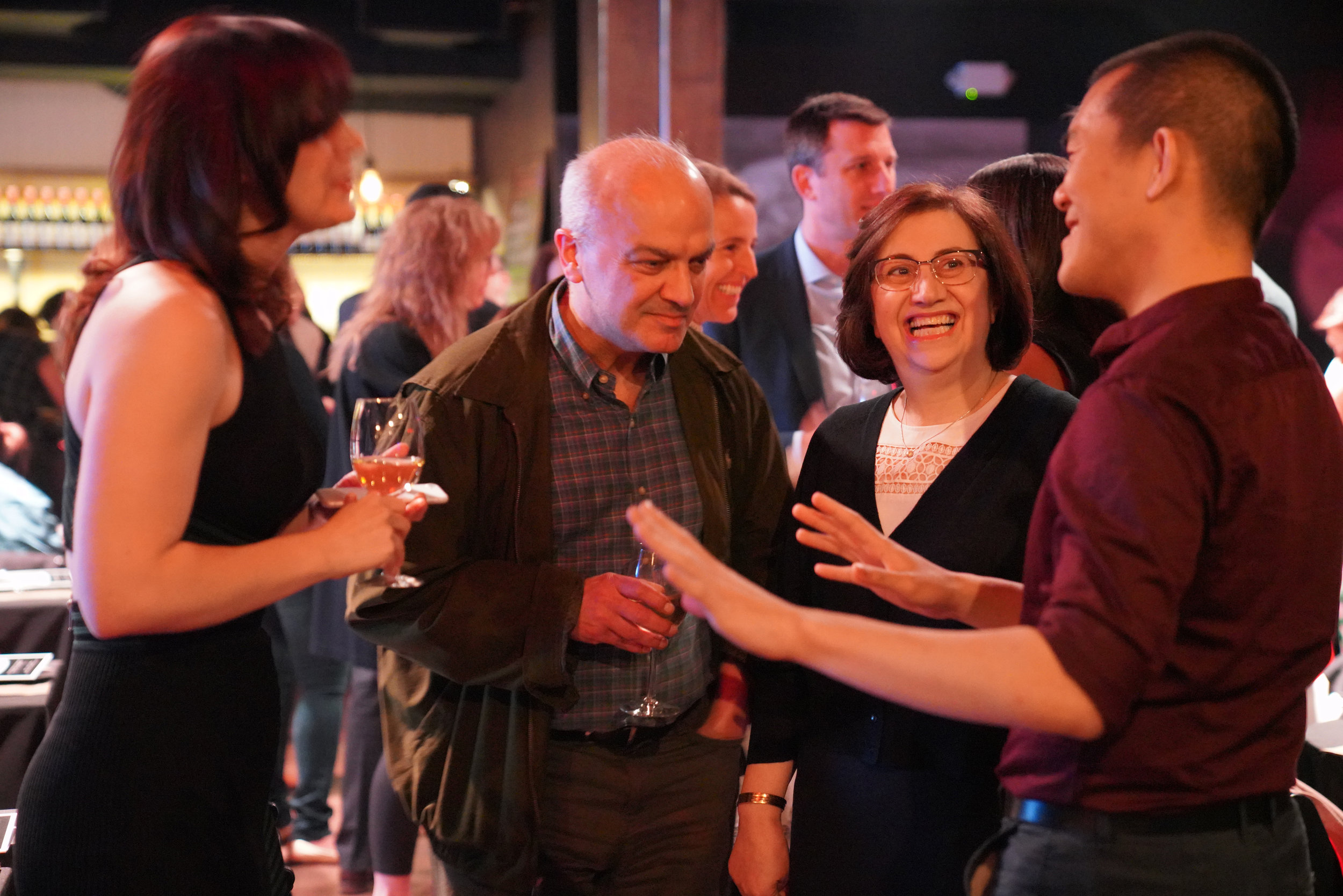 Story Collider executive director Liz Neeley (left) and host Ed Yong (right) chat with SC DC producer Maryam Zaringhalam's delightful parents during intermission.