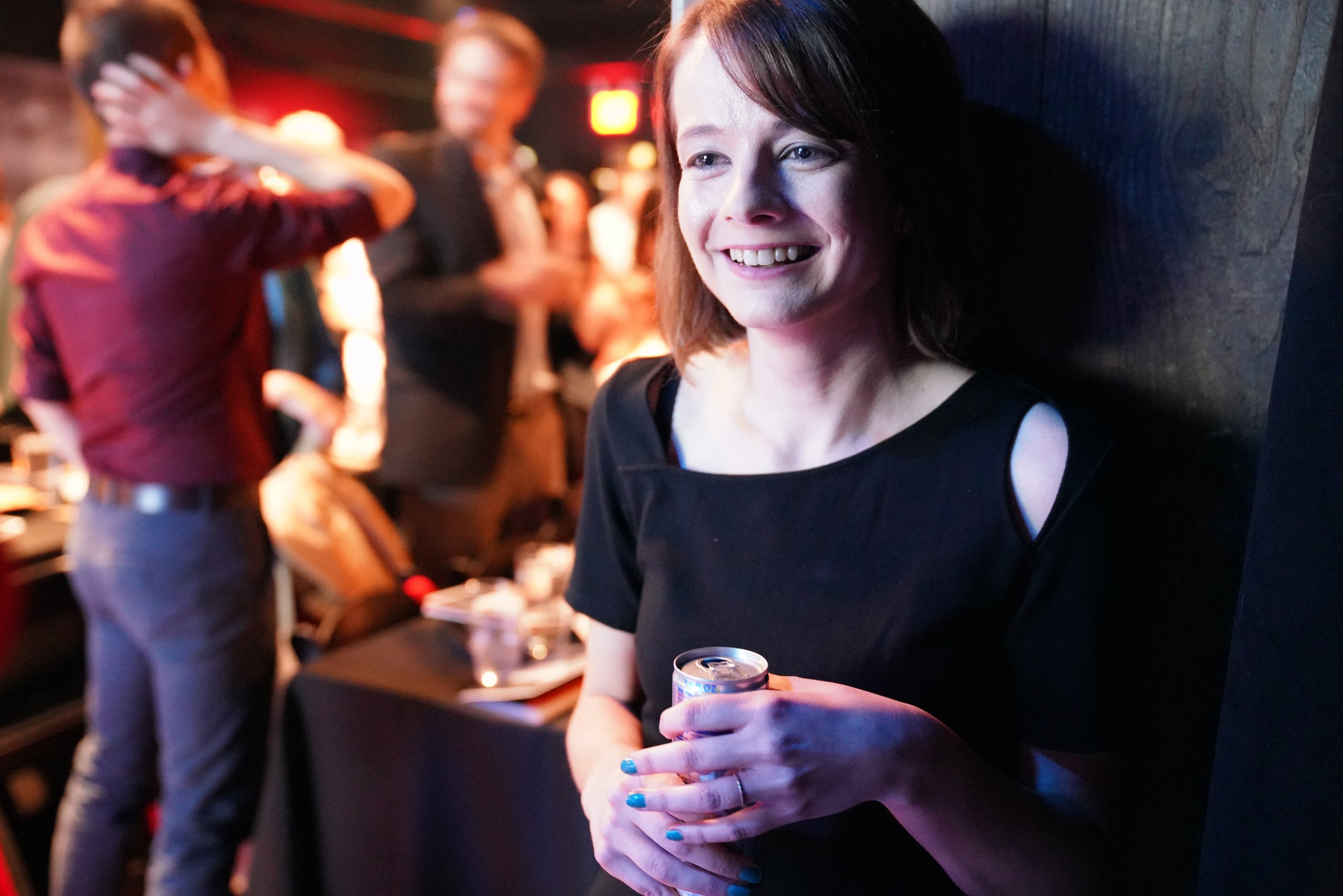 Story Collider artistic director Erin Barker savors her signature Red Bull while preparing to go on for the second half.
