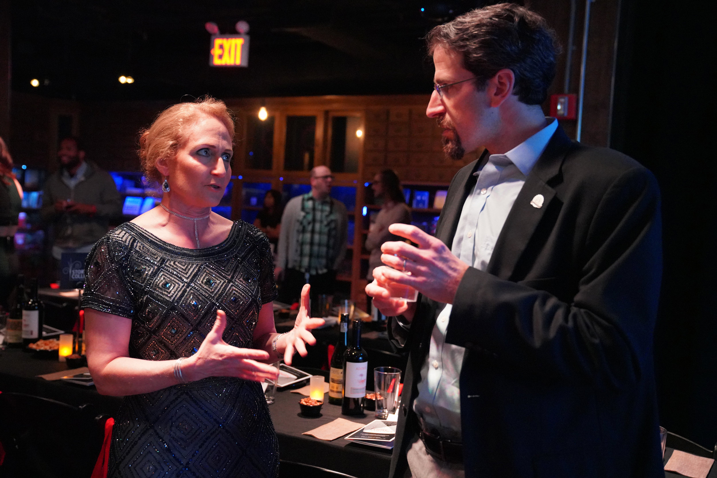 Jo Handelsman, director of the Wisconsin Institute for Discovery at UW-Madison and our third storyteller of the night, chats with her former colleague, Yale psychiatrist David Ross, also a Story Collider partner and donor.