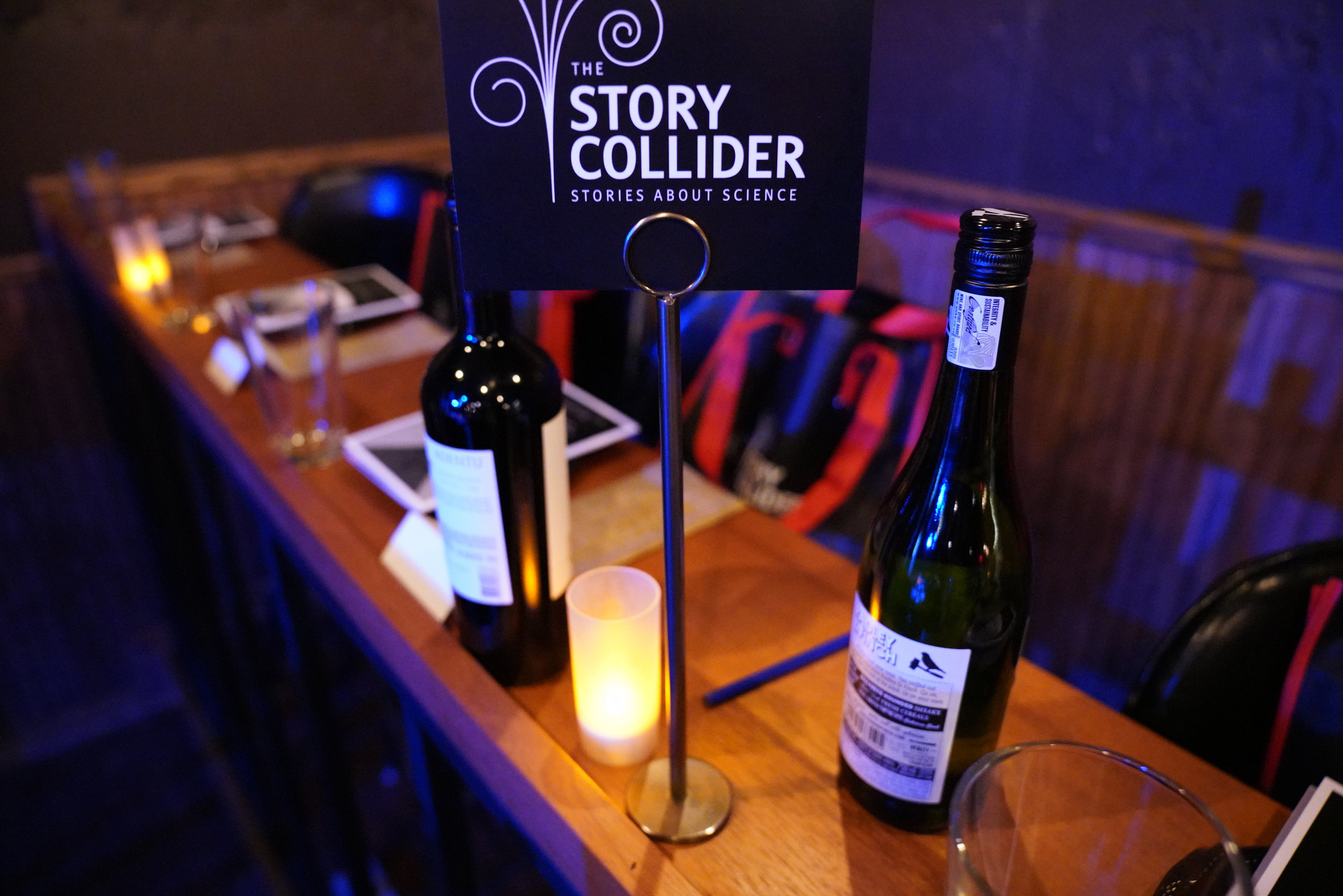 Gift bags and wine are all ready for our guests, thanks to Story Collider volunteers who worked diligently on setup! (Special thanks to  Lavender Wind Farm  for providing accessories for our gift bags!)