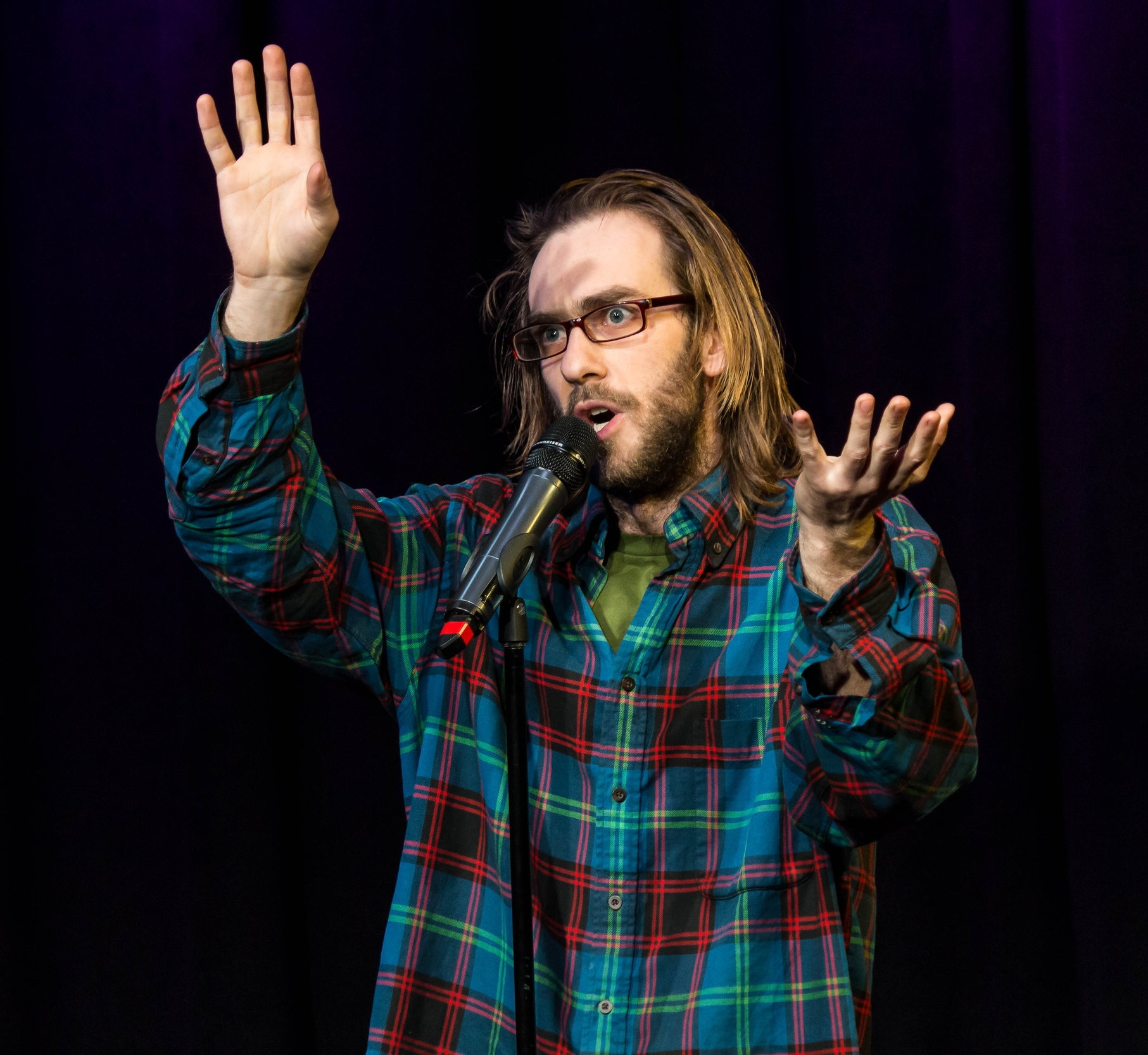 Nisse Greenberg shares his story at Caveat in New York in March 2018. Photo by Nicholas Santasier.