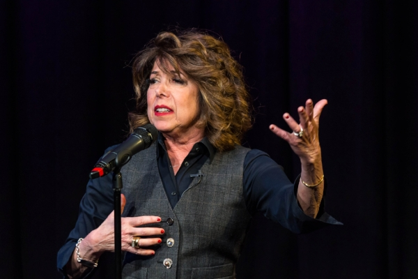 Sandi Marx tells her story at Caveat in New York City in March 2018. Photo by Nicholas Santasier.